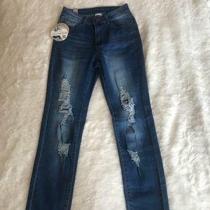 Distressed medium wash high waisted skinny jean